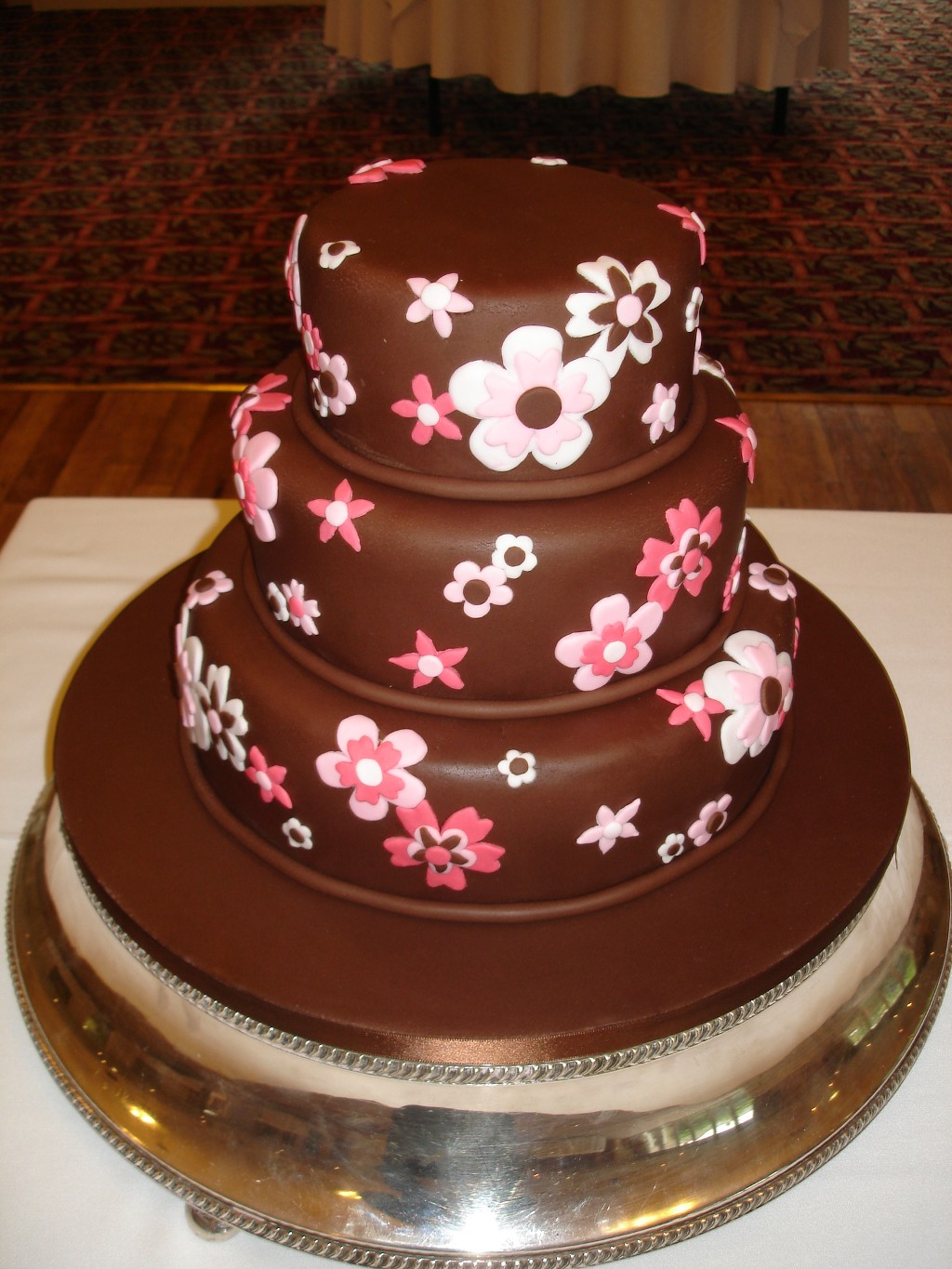 Three Tier Chocolate Iced Wedding Cake with Pink Flowers
