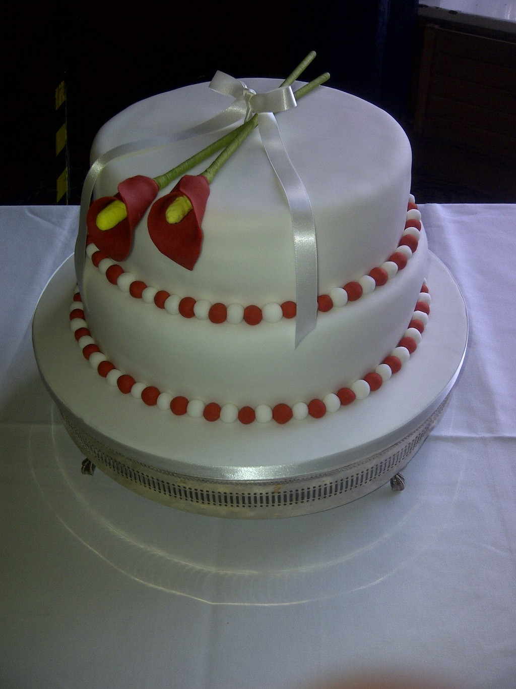 Two Tier White and Red Wedding Cake with Red Sugar Flowers