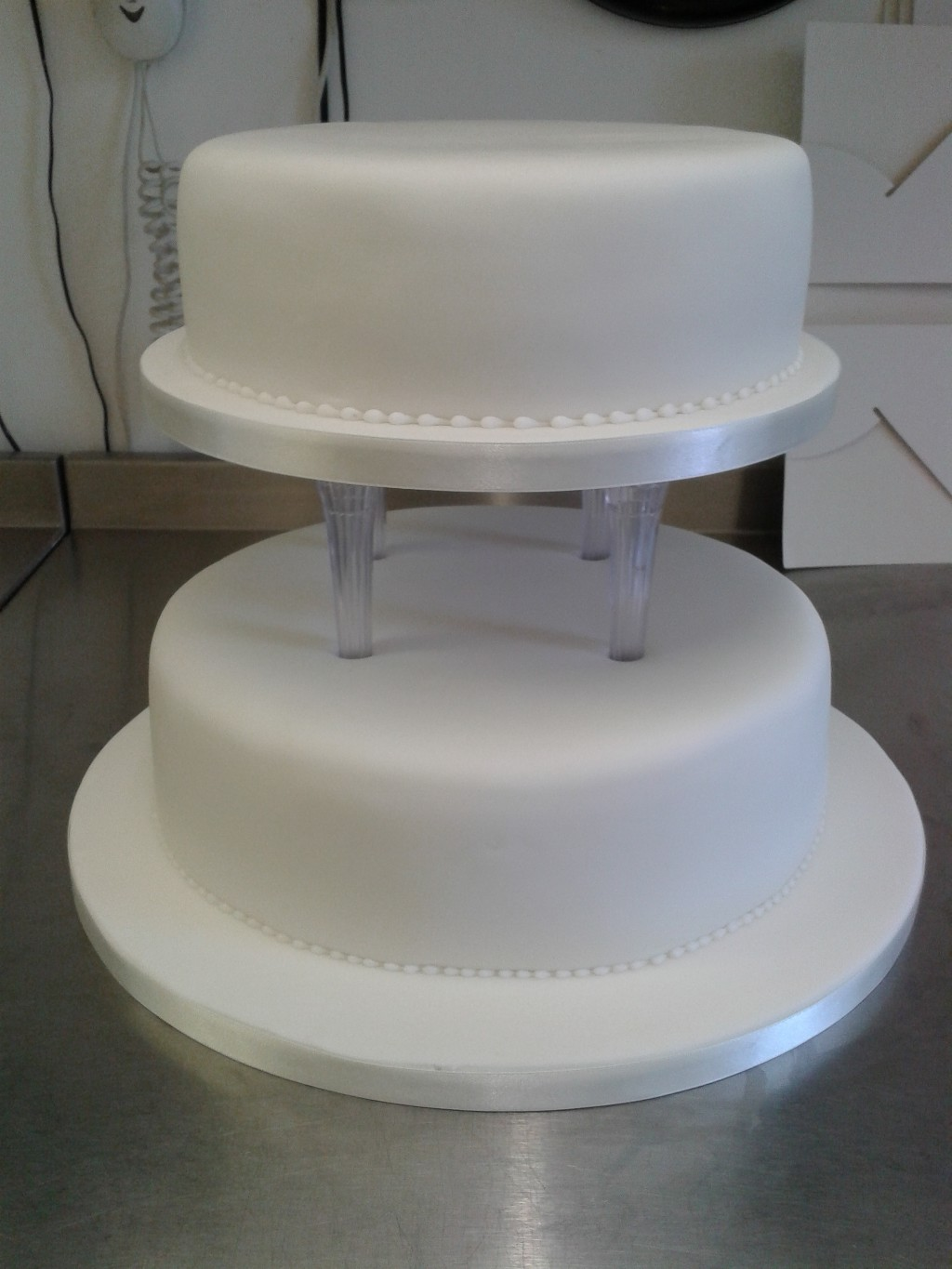 Plain Two Tiered Pillared Wedding Cake