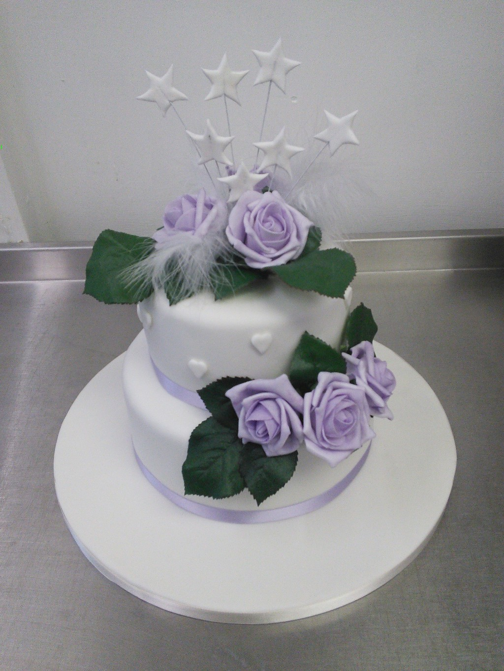 Stacked two tier wedding cake with lilac silk flower topper crumbs stacked two tier wedding cake with lilac silk flower topper junglespirit Image collections