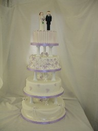 4 Tier Lilac and White Wedding Cake with Bride and Groom Topper