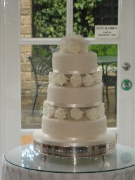 Three Tier Ivory Iced Wedding Cake with Silk Roses