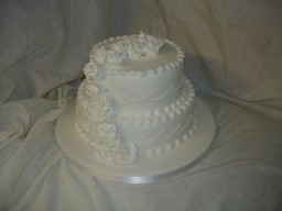 Two Tier White Iced Wedding Cake with Flower Cascade