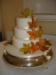 Three Tier White Iced Wedding Cake with Autumn Leaves