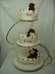Three Tier Ivory and Ruby Wedding Cake, on Golden S-Stand