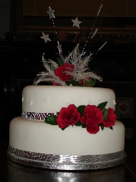 Two Tier, Stars and Roses Wedding Cake