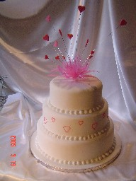 Three Tier White and Pink Heart Cake