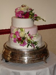 Three Tier Pink and White Wedding Cake with Real Bouquets