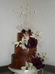 Three Tier Chocolate Ganache Wedding Cake with Burgundy and Ivory Flowers