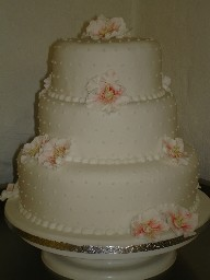 Three Tier, Dotted Ivory Wedding Cake with Iced Christmas Roses