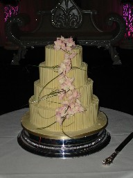 Four Tier White Chocolate Cigarillo Wedding Cake with Sugar Orchid Cascade