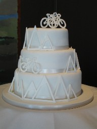 Three Tier White Wedding Cake with Mountains and Bikes