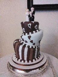 3 Tier Topsy Turvy Brown and White Stripes and Hearts Cake