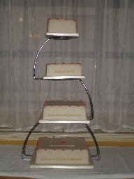 Four Tier Ivory Wedding Cake with Pink and Gold Decoration