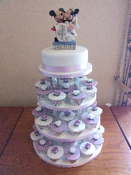 Lilac and White 1-Tier Wedding Cake with 3-Tier Rose Topped Cup Cakes