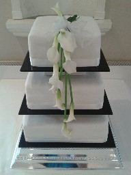 Simple Three Tiered Wedding Cake with Flower Topper