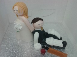 Bride and Cricket Groom Wedding Cake Topper