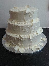 Ornate Cream Cheese Caoted, Three Tier Wedding Cake