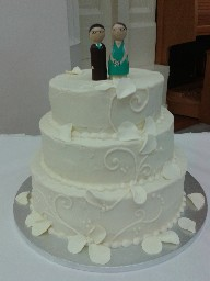 Ornate Three Tier Wedding Cake with Wooden Bride and Groom Topper