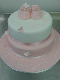 Blossom and Butterfly Christening Cake with Bootie Topper